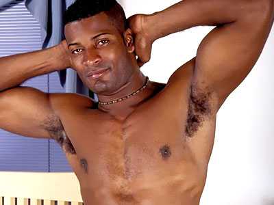 Muscled black gay shows off his hot abs and drops his pants to play with his dick